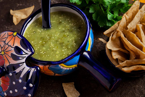 Green Salsa accompanied with tortilla chips